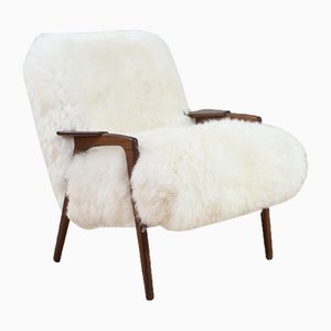 Model Ruster Sheepskin & Teak Armchair by Yngve Ekström for Pastoe, 1960s