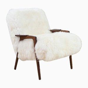 Modell Ruster Sessel mit Gestell aus Teak & Bezug aus Schafsfell von Yngve Ekström für Pastoe, 1960er