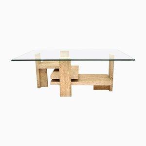 Tavolino da caffè scultoreo in travertino con ripiano rettangolare in vetro di Willy Ballez, anni '70