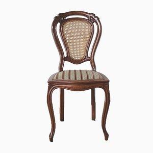 Antiker Stuhl mit Rückenlehne aus Rattan