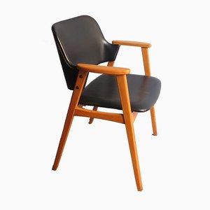 Poltrona con schienale e seduta in similpelle nera, anni '60