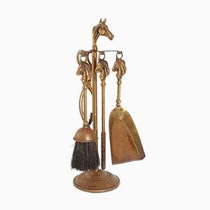 Accessori da camino vintage in ottone dorato con decorazioni a forma di teste di cavallo