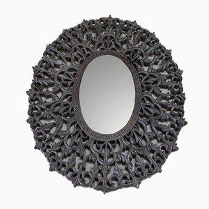 Espejo de pared antiguo de teca tallada