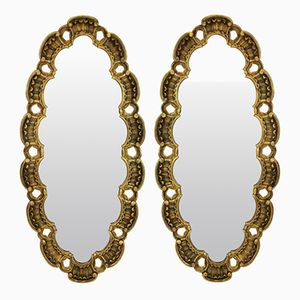 Espejos Mid-Century de madera dorada. Juego de 2