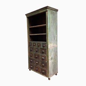 Mueble de tienda antiguo con 16 cajones