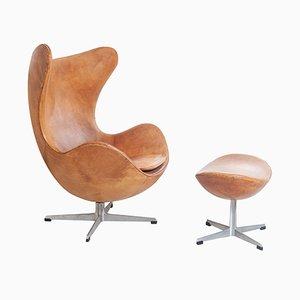 Egg chair vintage con poggiapiedi di Arne Jacobsen per Fritz Hansen