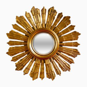 Espejo francés en forma de sol dorado, años 30