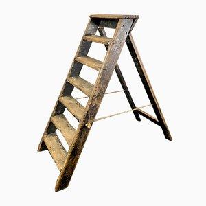 Estantería vintage de madera con escalera