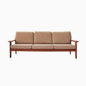 Sofá de tres plazas de teca, años 60