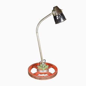 Lampada da tavolo industriale con base a forma di ruota, anni '70