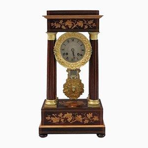 Reloj de repisa francés antiguo de palisandro y madera satinada con pórtico, años 70