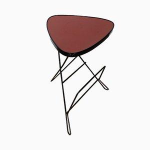 Tavolino tripode rosso con portariviste, anni '50