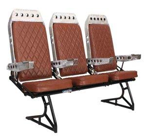 Fila de asientos de avión vintage, años 70