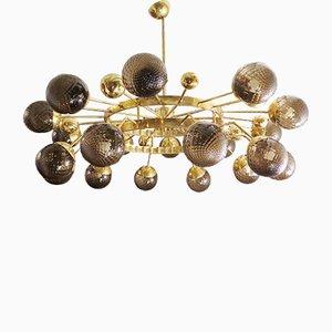 Lámpara de araña Mid-Century de cristal de Murano y latón, años 50
