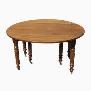 Tavolo antico allungabile in legno di noce