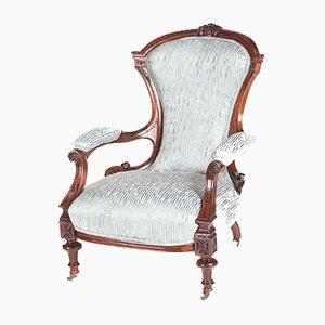 Butaca victoriana antigua de palisandro tallado