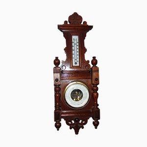 Barómetro y termómetro antiguos de madera