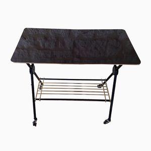 Tavolino Mid-Century in formica, ottone e metallo con rotelle di CSA