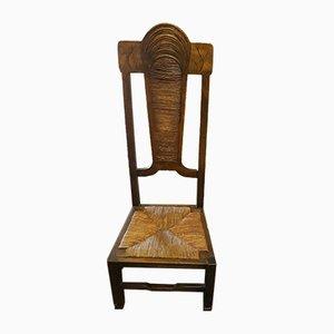 Sedia bassa con seduta in paglia, anni '50