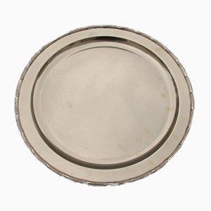 Bandeja redonda de latón macizo grabado, años 70