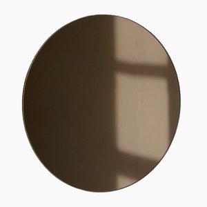 Mittelgroßer runder bronzefarbener Orbis Spiegel von Alguacil & Perkoff Ltd