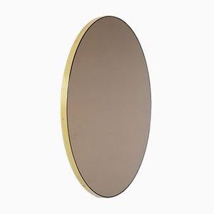 Runder mittelgroßer bronzefarbener Orbis Spiegel mit Messingrahmen von Alguacil & Perkoff Ltd