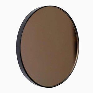 Specchio XL Tinted Orbis rotondo in bronzo con cornice nera di Alguacil & Perkoff Ltd