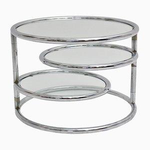 Mesa de centro vintage redonda cromada con superficies giratorias