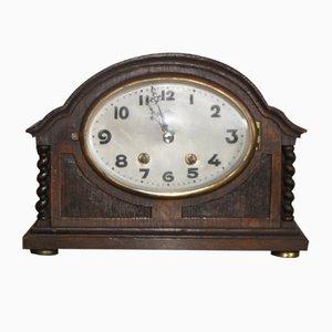 Orologio antico in legno