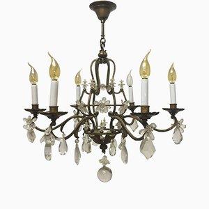 Lámpara de araña de hierro dorado y cristal de Maison Baguès, años 40