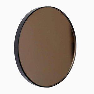 Espejo Orbis grande redondo de bronce tintado con marco negro de Alguacil & Perkoff Ltd