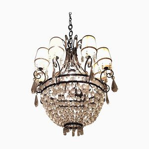 Lámpara de araña antigua de hierro y vidrio
