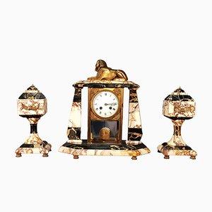 Orologio vintage con vetrina, sfinge e ornamenti