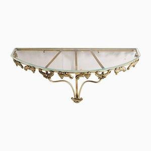 Consola estilo barroco de bronce dorado y cristal, años 50