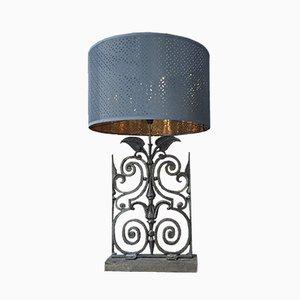 Lámpara de mesa antigua de hierro fundido