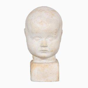 Skulptur eines Kindergesichts von Elisa Tetens Lund, 1932