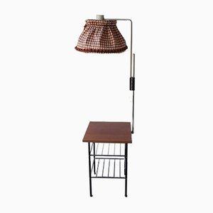 Lámpara de pie con una mesa y revistero, años 60