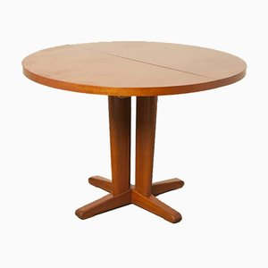 Mesa de comedor extensible redonda de caoba, años 60