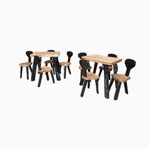 Juego de mesa y cuatro sillas vintage de olmo