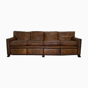 Sofá de cuatro plazas vintage de cuero marrón