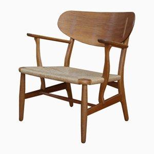 Chaise longue CH22 di Hans J. Wegner per Carl Hansen & Søn, anni '50