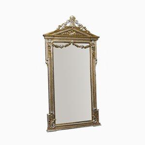 Specchio vittoriano in legno intagliato e placcato in argento e oro