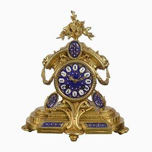 Reloj de metal dorado y repisa esmaltada, década de 1870