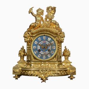Reloj de repisa francés dorado, década de 1860