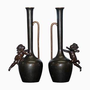Jarrones en forma de querubín vintage de bronce, años 30. Juego de 2