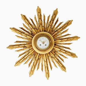 Reloj de pared antiguo en forma de sol de abedul dorado