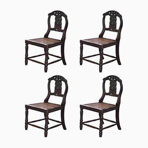 Chinesische Esszimmerstühle aus ebonisiertem & geschnitztem Holz mit Dekor in Schlangen-Optik, 19. Jh., 4er Set