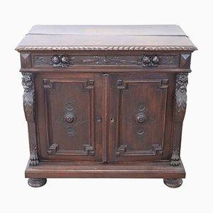 Credenza antica in legno di noce intagliato