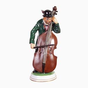 Figurina in porcellana raffigurante un suonatore di controbasso di Karl Himmelstoss per Rosenthal, anni '20