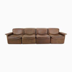 Sofá de cuatro plazas DS-12 vintage de cuero marrón de de Sede, años 70